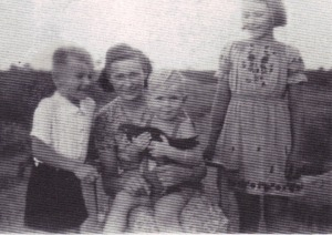 Our Polish maid, Maria, with  the three of us, Summer 1944