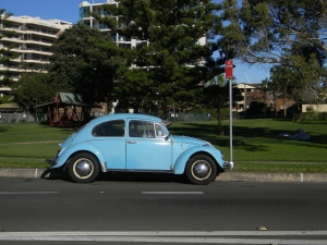 Peter saw this beautiful little car in the street and took a picture of it.