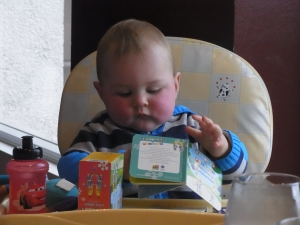 We're still waiting for Mark to arrive. In the meantime Lucas plays with his books.