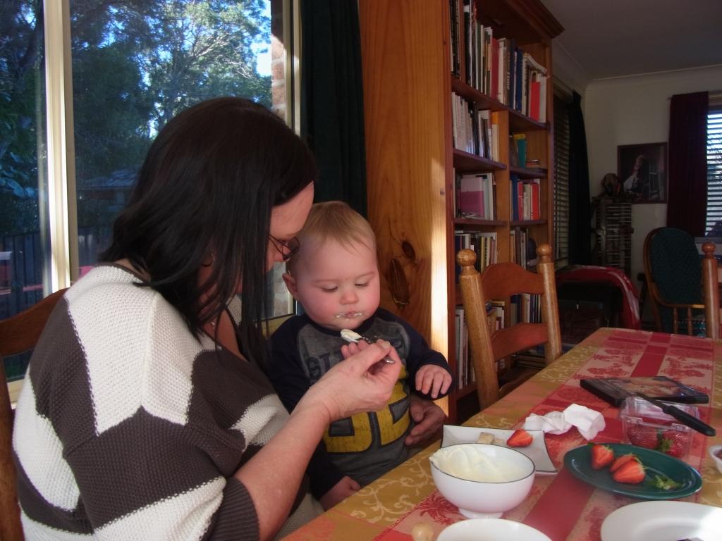Monika feeds Lucas some yoghurt with honey.