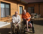 Peter and David in an outside area of the Nursing Home