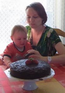 Lucas with Aunt Caroline admires the cake