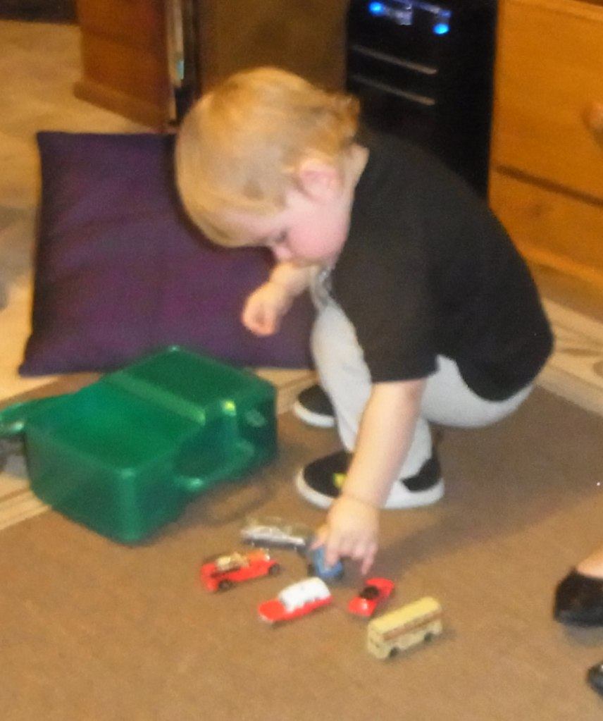 Lucas liked to play again with some toy cars.