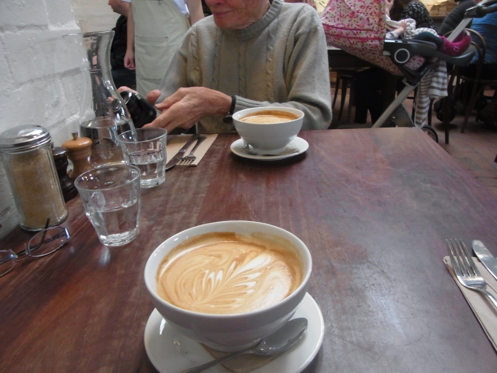 Soon our coffee was served in big cups.  The pram in the background was a joy to watch it kept bouncing up and down the way a cradle would.