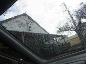This picture is taken through the wet windscreen of the car.