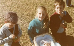 Here are Caroline and the Twins with Baby Tristan at Stuart Park, North Wollongong, on the 18th August 1985.