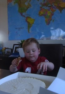 Lucas has a look at the cheese-cake.