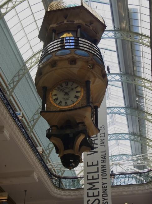 The huge clock inside of Queen Victoria Building.