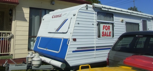 I saw this caravan FOR SALE  in front of one house.