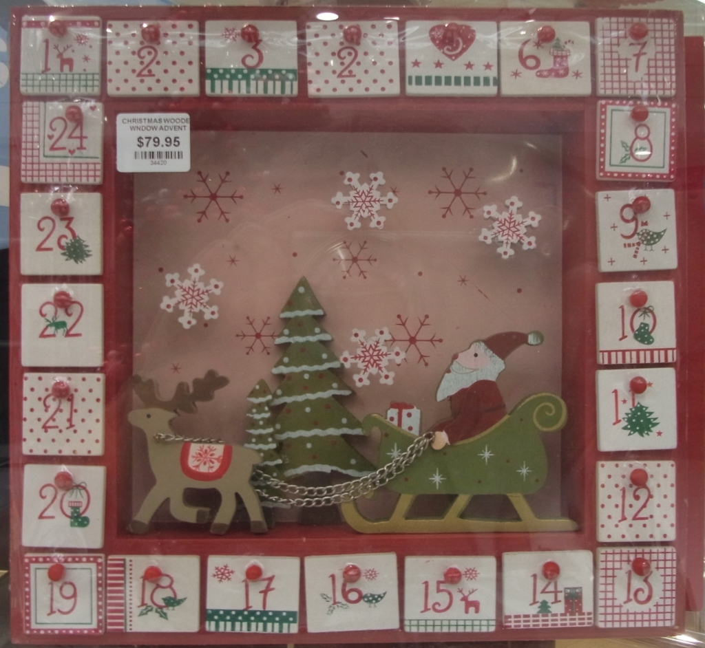 I noticed this wooden Advent calendar in the window.