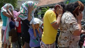 Image courtesy of SMH - Sri Lankan refugees sent back by Australia enter court in Sri Lanka