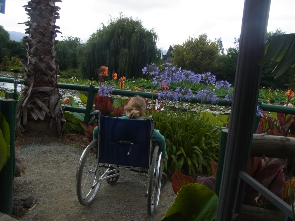 Kia tries out my wheelchair.