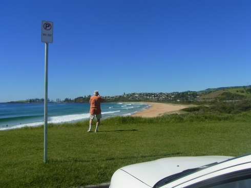 Sitting in the car I took this picture of Peter photographing Bombo Beach.