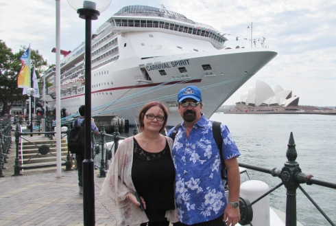 Monika and Mark posing in front of this ship they were soon going to board for their twelve day cruise.