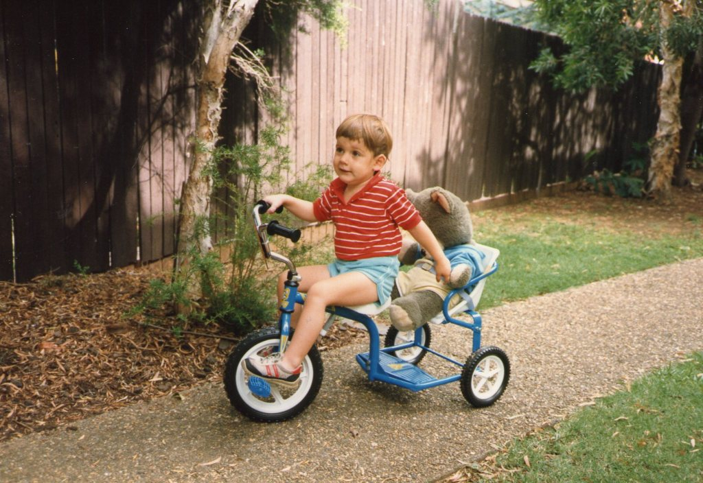Tristan is two and a half years old riding his bike at Ashfield, Dec. 1987