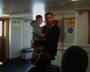 Lucas with his uncle Troy on the boat
