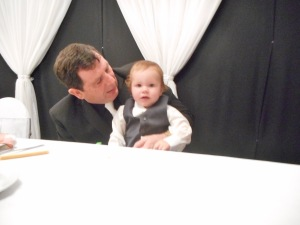 The bride's father with little Alexander.