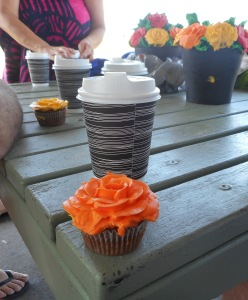 The coffee has arrived and we can eat the cup cakes.