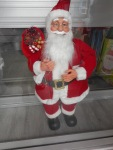 Father Christmas in the Window of a Shop