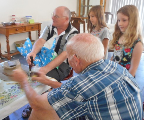 The girls with their granddad and great-granddad.
