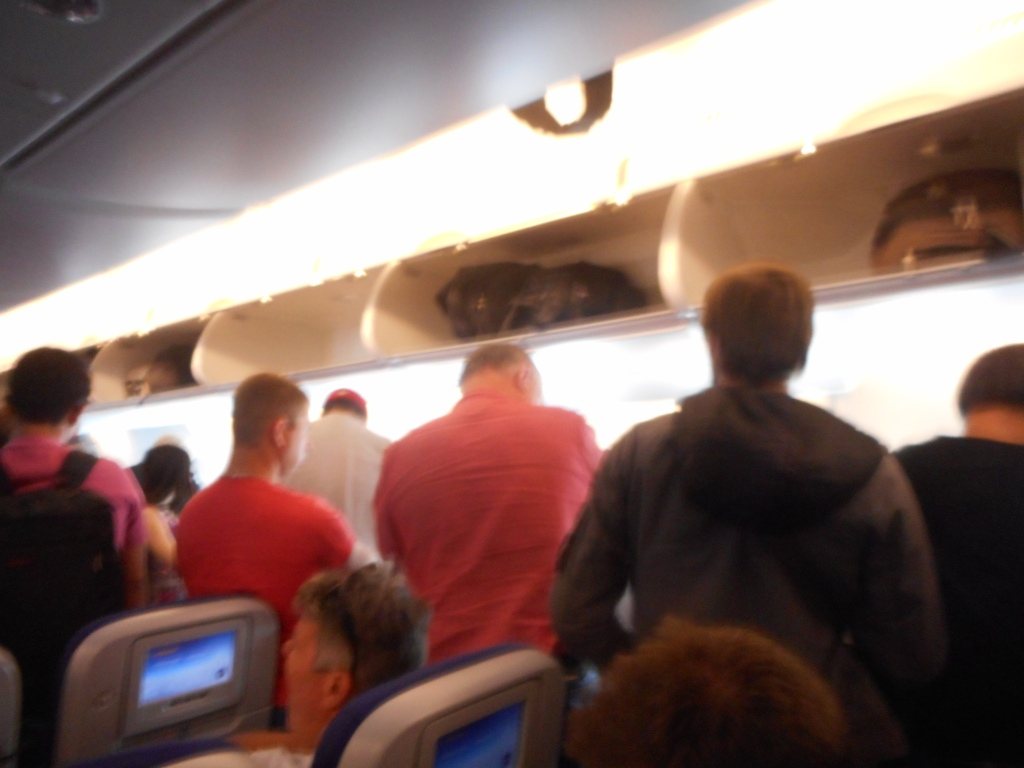 Martin in the middle about to disembark after we landed in Singapore.