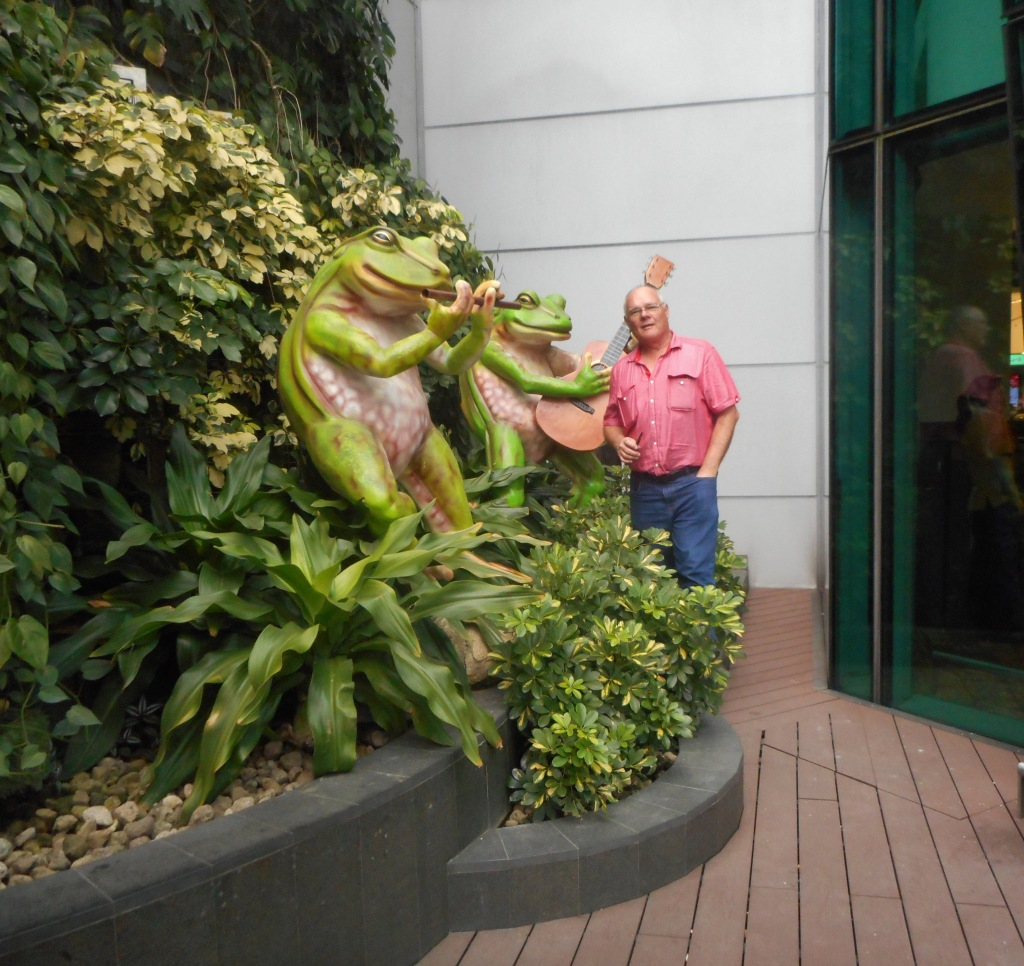 Martin posing for a photo in the outside garden area of Singapore Airport Evening of 1st of July 2016