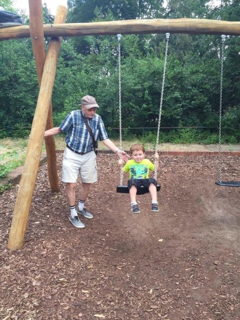 Peter gives Alexander a swing in that Kreuzberg park.