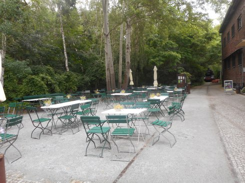 The cafe, that was closed, had a lot of outside seating available.