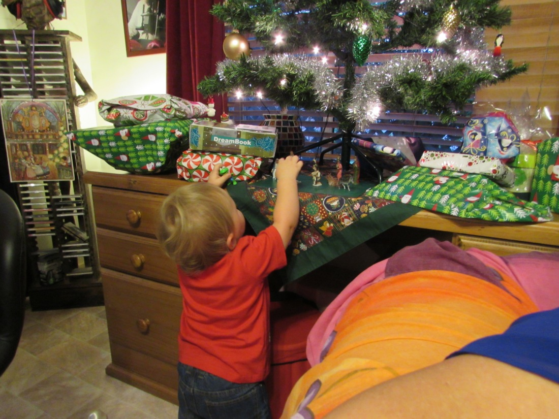 Little Lucas under the Christmas Tree